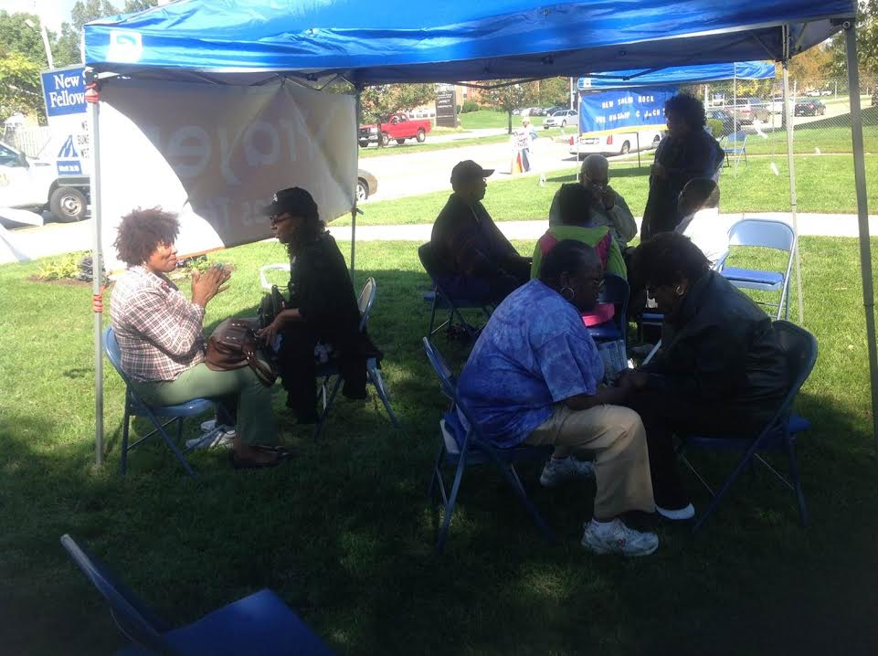 People Praying in the Prayer Tent